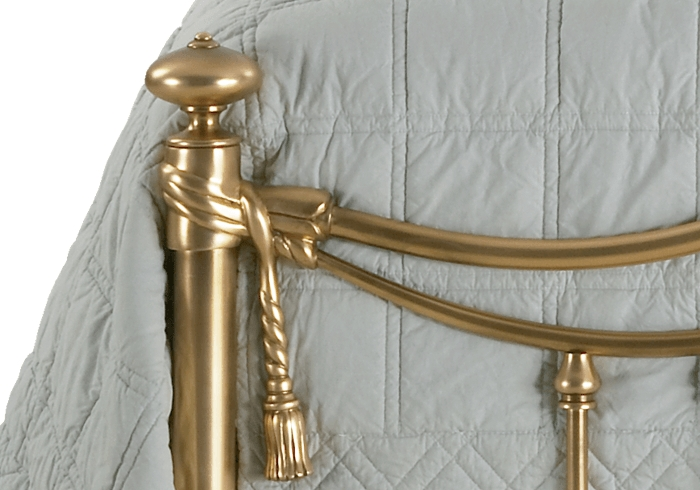 Side casting close up of the Armoy brass bed
