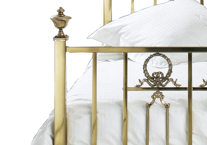 Side casting close up of the Ayr brass bed
