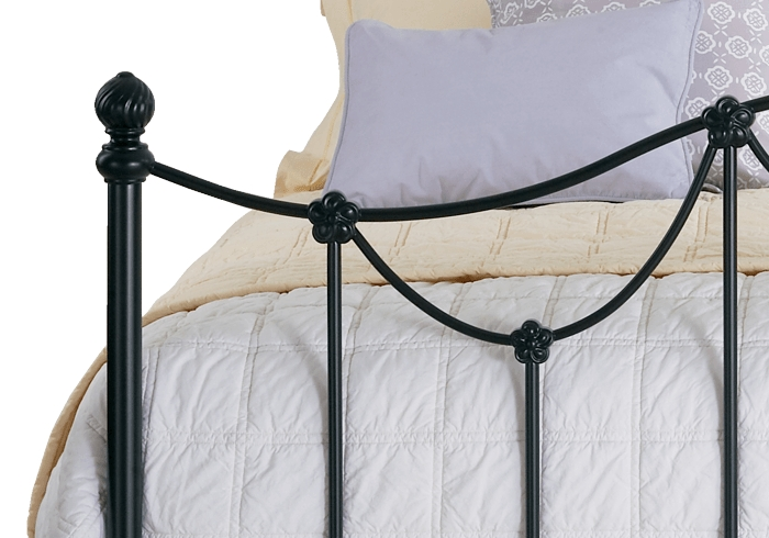 Side casting close up of the Carie iron bed