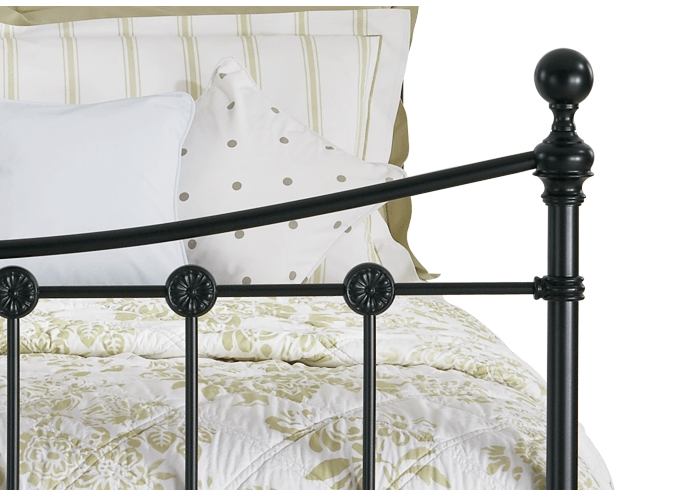 Side casting close up of the Carrick iron bed