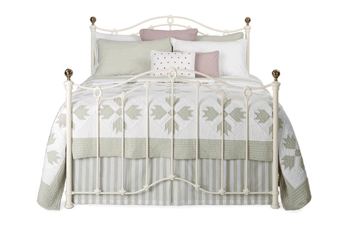 Clarina iron bed in glossy ivory with antique brass knobs