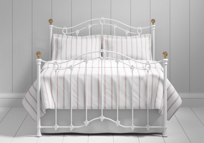 Clarina iron bed in white with brass knobs