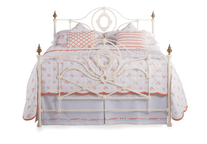 Constance iron bed in glossy ivory with antique brass knobs