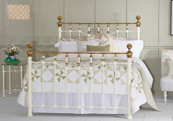 Glenshee iron bed in glossy ivory with antique brass knobs