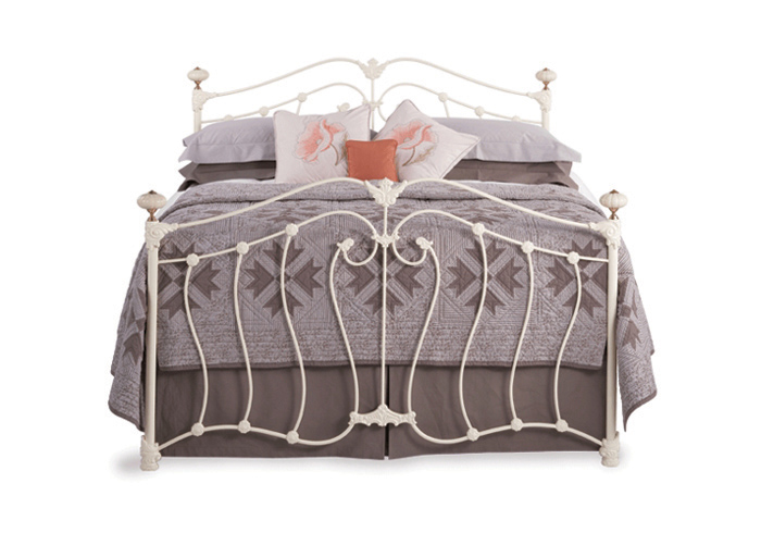 Lisburn iron bed in silver patina with gold highlights with antique brass knobs