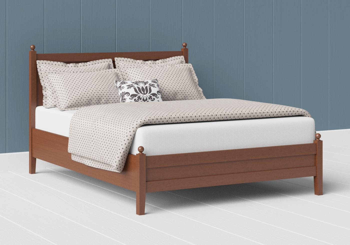 Marbella low footend wood bed in a dark cherry finish