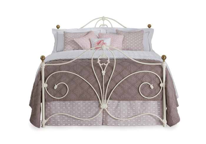 Melrose iron bed in glossy ivory with antique brass knobs