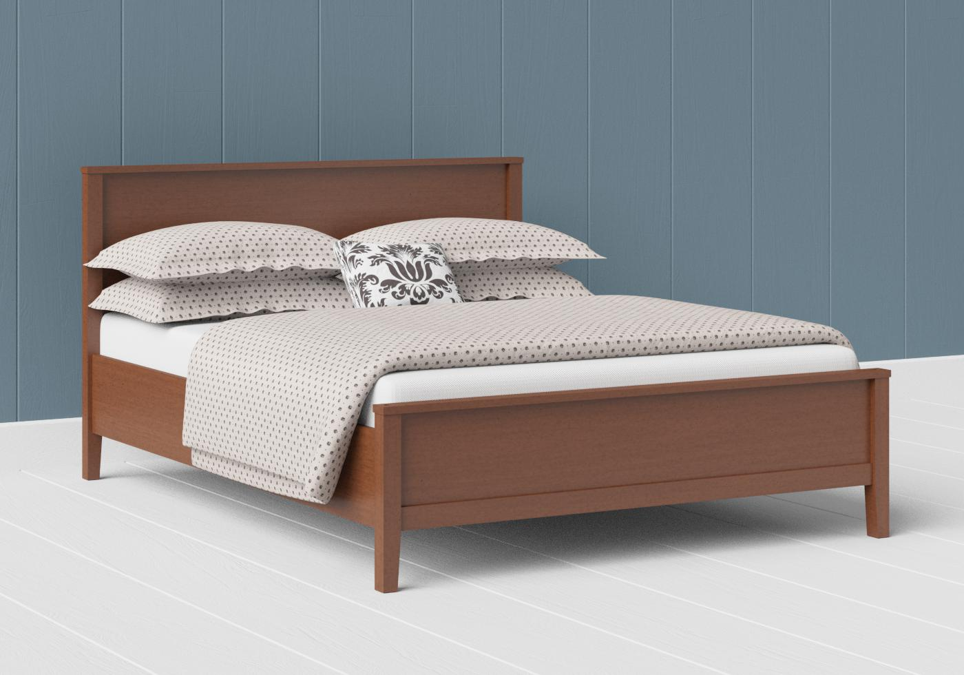 Ramsay low footend wood bed in a dark cherry finish
