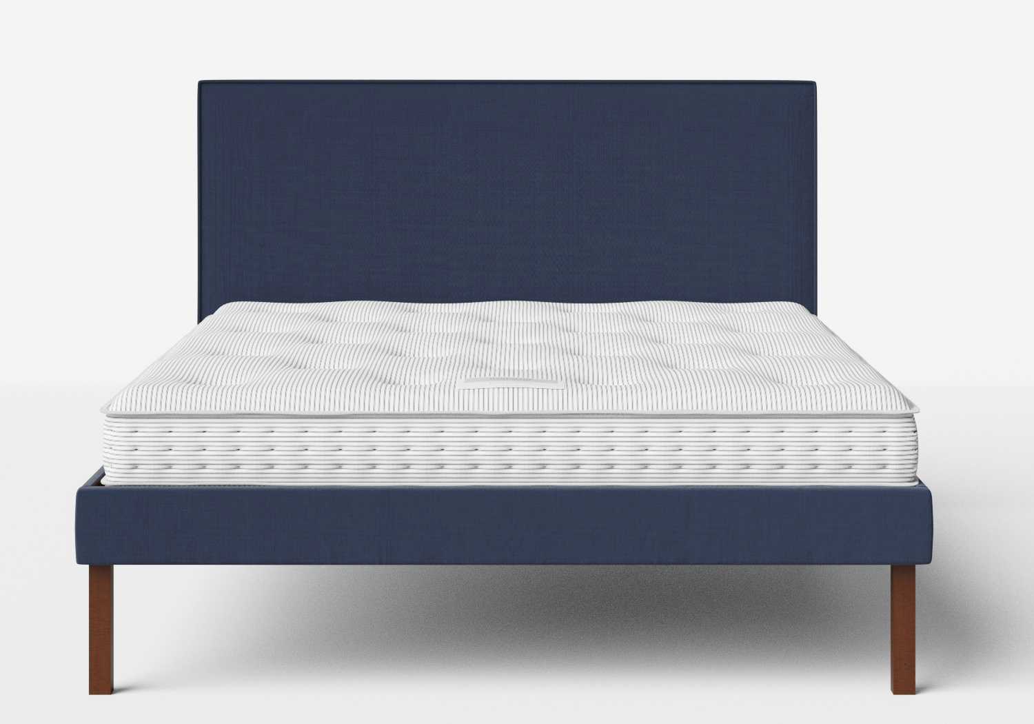 Misaki Upholstered Bed in Navy fabric with piping shown with Juno 1 mattress