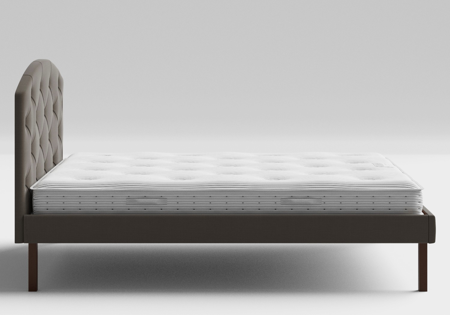 Okawa Upholstered Bed in Grey fabric with buttoning shown with Juno 1 mattress