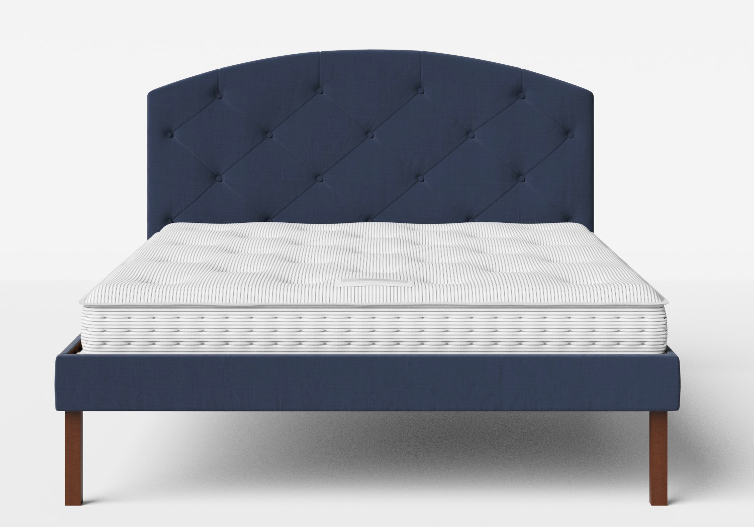 Okawa Upholstered Bed in Navy fabric with buttoning shown with Juno 1 mattress
