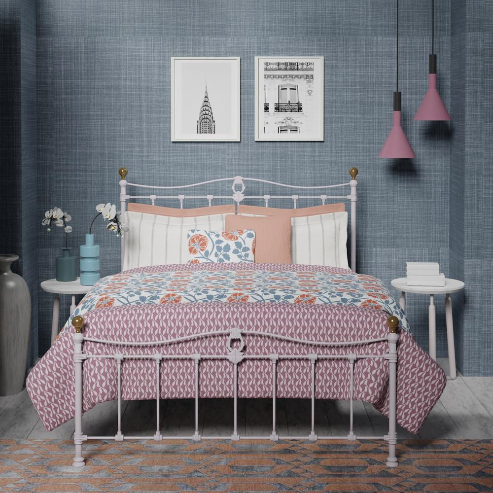 Tulsk iron bed in white with pink and orange linens