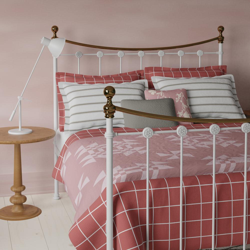 Carrick iron bed in white with pink linens