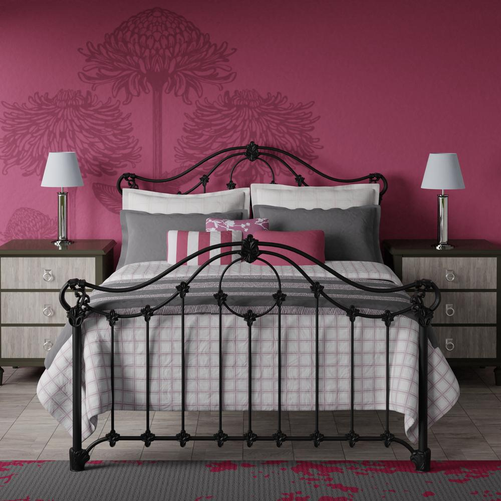 Alva bed in black, with a bright pink wall and grey linens