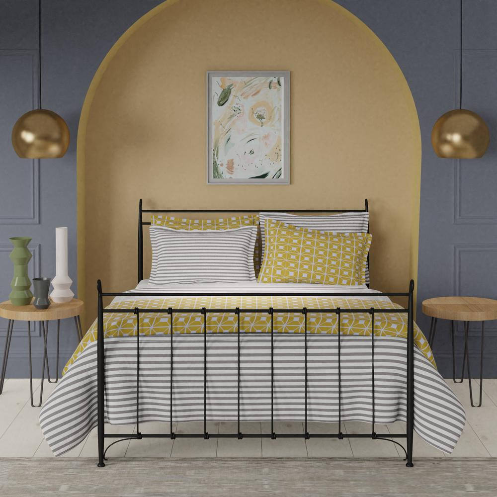 Tiffany iron bed in black with yellow linens