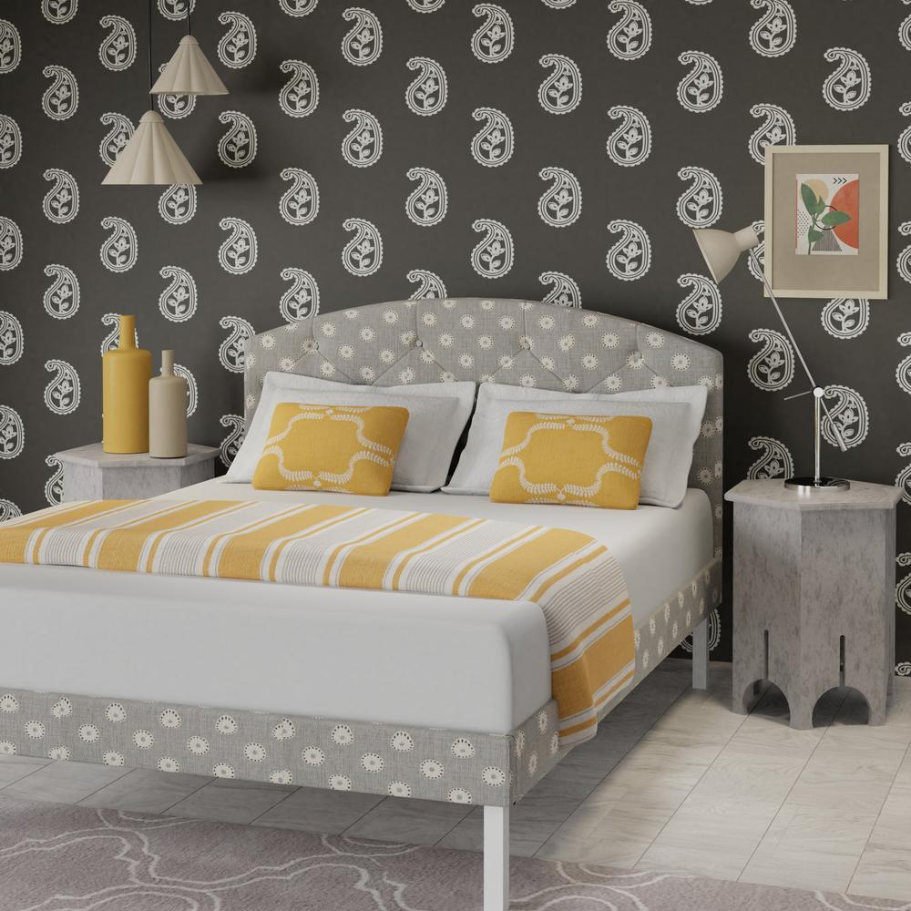 Okawa upholstered bed in grey with yellow pillows